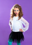 Children fashion makeup kid girl on purple royalty free stock images