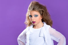 Children fashion makeup kid girl on purple royalty free stock photography