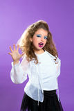 Children fashion scaring makeup kid girl on purple Stock Photo