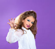 Children fashion scaring makeup kid girl on purple royalty free stock images