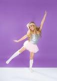 Children fashiondoll spring girl dancing on purple Stock Photography