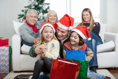 Children And Father With Gifts During Christmas Royalty Free Stock Photo