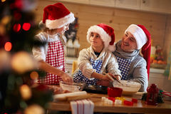 Children and father making Christmas cookies Stock Photos