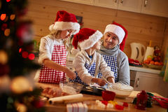 Children and father preparing Christmas cookies Royalty Free Stock Photo