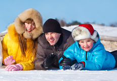 Children with father on snow Stock Images