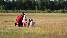 Children with the father spend time together in the field stock footage