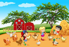 Children feeding animals in the farm
