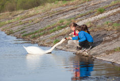 Children feeding swan Stock Image