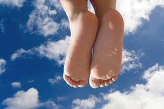 Children Feet. Isolated with a cloudy sky above - with clipping path stock photography