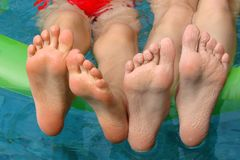 Children feet in a swimming pool. Children feet having fun in a swimming pool Royalty Free Stock Photography