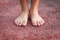 Children feet in the park Stock Image