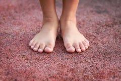 Children feet in the park Stock Image