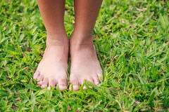 Children feet in the park Stock Images