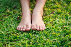 Children feet in the park Stock Photo