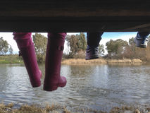 Children feet sitting over old fisher platform Stock Photography