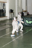 Children fencing with epee Stock Image