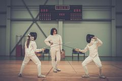 Children on a fencing training Stock Photos