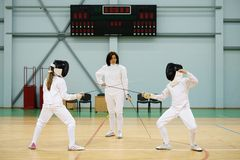 Children on a fencing training Stock Images