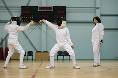 Children on a fencing training Stock Photography
