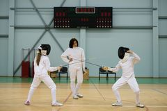 Children on fencing training Stock Images
