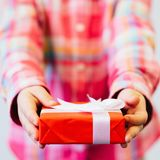 Children festive wrapped gift for parents royalty free stock photo