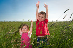 Children in field Royalty Free Stock Images