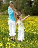 Children in field with flower. Stock Photo