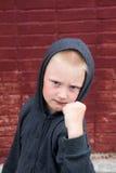 Children fight. Near brick wall Stock Photos