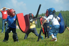 Children fighting with shield Royalty Free Stock Photo