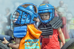 Children fighting with shield Royalty Free Stock Images
