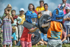 Children fighting with shield Stock Images