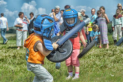 Children fighting with shield Royalty Free Stock Photos