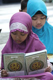 Children fill the school holidays by reading the Qur'an in one of the non-formal education in the city of Solo, Central Java Indon. Esia stock photo