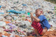 Children find junk for sale and recycle them in landfills, the l royalty free stock photography