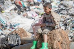 Children find junk for sale and recycle them in landfills, the lives and lifestyles of the poor, Child labor, Poverty and. Environment Concepts royalty free stock photo