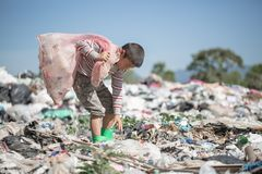 Children find junk for sale and recycle them in landfills, the lives and lifestyles of the poor, Poverty and Environment Concepts.  royalty free stock photos