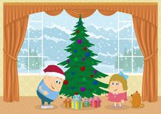 Children finding gifts under fir tree Royalty Free Stock Photo