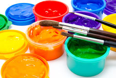 Children finger paint and paintbrushes Royalty Free Stock Photography