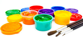 Children finger paint and paintbrushes isolated Royalty Free Stock Images