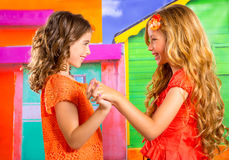 Children firends girls in vacation at tropical colorful house. Children firends girls playing together in vacation at tropical colorful house Royalty Free Stock Images