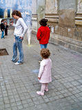 Children with Fireworks in the Street during the annual Celebration of Las Fallas, Valencia, Spain. File Photo:nnThe Falles (Valencian: [ˈfaʎes] ( listen) Royalty Free Stock Photo