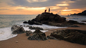 Children fishing at beach during sunset. Children fishing at Kalim beach during sunset in Phuket, Thailand Royalty Free Stock Image