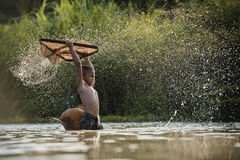 Children fishing. Boy with fishing net catching fish in the summer. Concept for childhood, healthy lifestyle and vacation,children fishing in the river Royalty Free Stock Photos