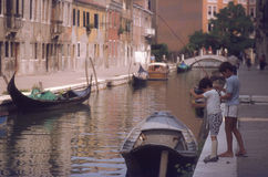 Children fishing in canal in Venice Stock Image