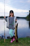 Children fishing. Cute young girl with big pike Stock Images