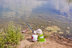 Children fishing. Children having a good time fishing Stock Photos