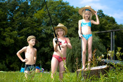 Children fishing at the lake Stock Photos