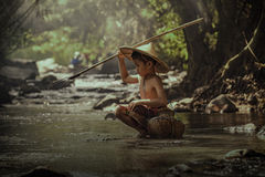 Children are fishing Stock Images