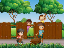 Children fixing fence in the park Stock Images