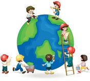 Children fixing and painting the globe Stock Image